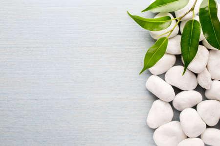 white pebble: White pebble stone frame and leaf on white Background.