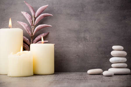 spa candles: Stones spa treatment scene, zen like concepts. Stock Photo