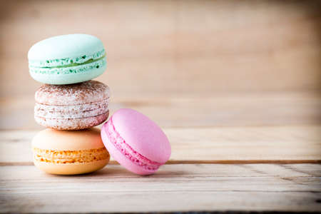 small group of objects: Macaroons and  the table. Dessert background. Studio shoot. Stock Photo