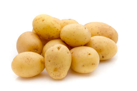 spud: Potatoes on the white background.  New harvest.