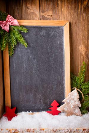 christmas decor: Christmas background blackboard with festive decor. Stock Photo