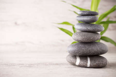 tranquil: Spa stones on the grey background.