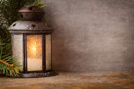 lighting background: Lantern with christmas tree, Christmas decor. Greeting Card.