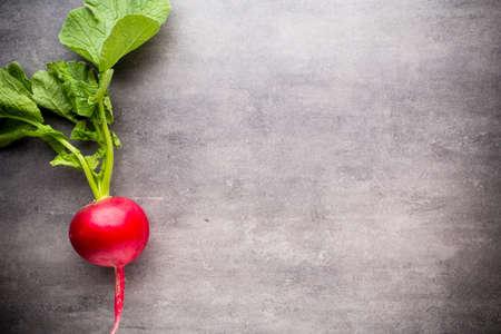 radishes: Radishes on the grey background. Still life.