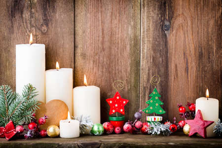 candle: Christmas Advent candles with festive decor. Stock Photo