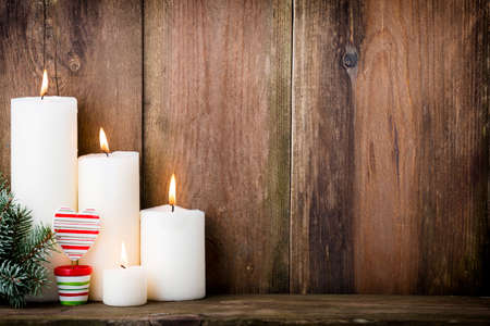 peaceful scene: Christmas candles and lights. Christmas background.