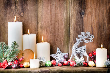 advent candles: Christmas Advent candles with festive decor. Stock Photo