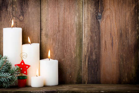 candle flame: Christmas candles and lights. Christmas background.