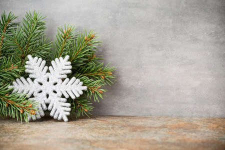 christmas star: Gray metall texture with decor and firtree. Stock Photo