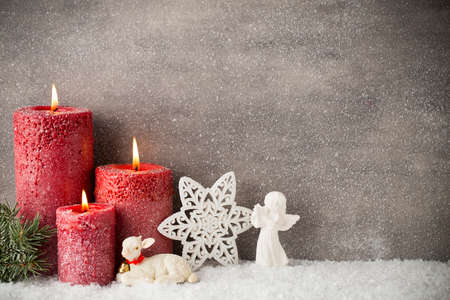 Three red candles on gray background, Christmas decoration. Advent mood. 스톡 콘텐츠