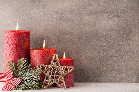 Christmas candles and lights. Christmas background. Reklamní fotografie - 49444141