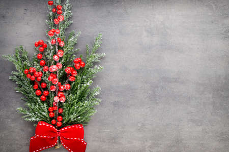 christmas decor: Christmas tree branch and decor, on the vintage background. Stock Photo