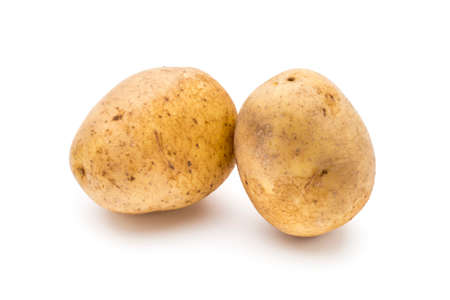spud: Potato isolated on white background close up.