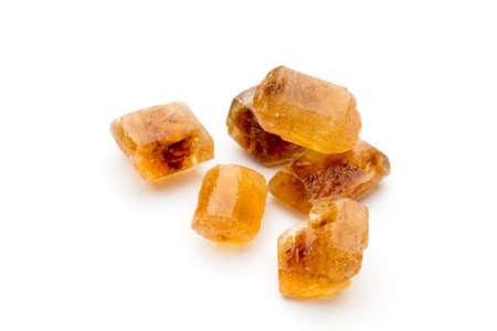 caramelized: Large caramelized sugar on a white background. Stock Photo