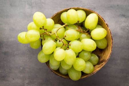 grape cluster: Grape cluster on the grey background.
