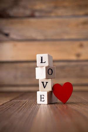 Love message written in wooden blocks. Red heart.