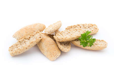 Bread crisps with herbs on a white background.