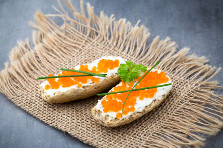pumpernickel: Sandwiches with butter and red salmon. Stock Photo