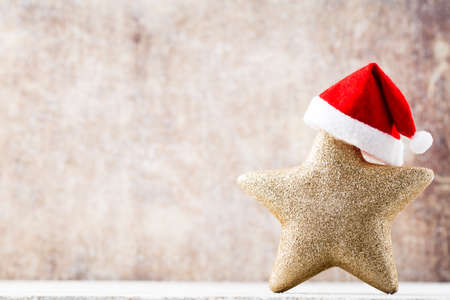vintages: Christmas star with Santa hat. Vintages background. Stock Photo