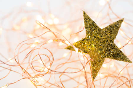 beautify: Christmas gold stars decoration on abstract background.