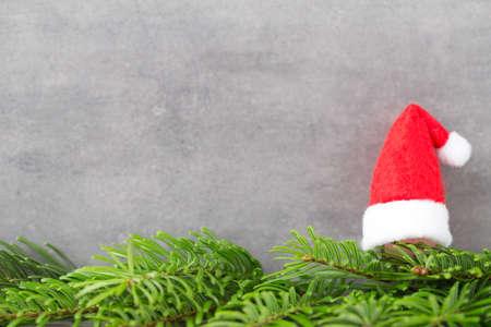 vintages: Christmas decor with angel santa hat. Vintages background.