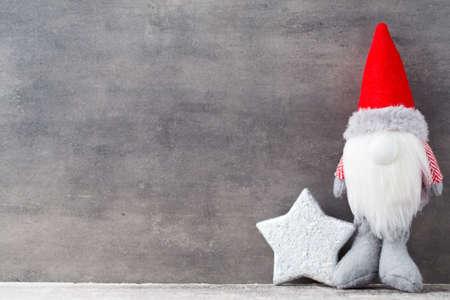 Christmas gnome decor with santa hat. Holiday bohek background. Stock Photo
