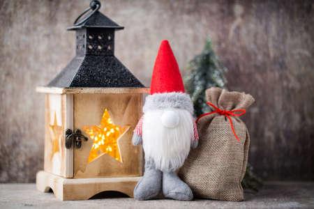 Christmas  lantern decor with gnome. Holiday greeting card. Stock Photo