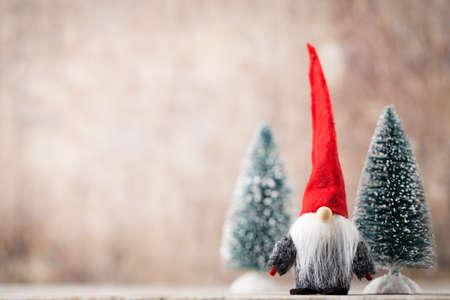 Christmas greeting card. Noel gnome background. Christmas symbol.