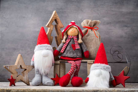 Red Gnomes With Card, Copy Space. Stock Photo
