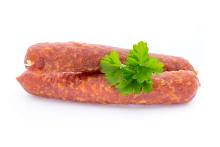 salame: Swiss style peperoni or salami, parsley sausage. Isolated on white background. Stock Photo