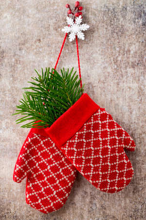 Christmas gloves on the gift card wooden background. Stock Photo