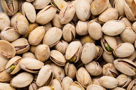Background make from fresh salt pistachios. Stock Photo
