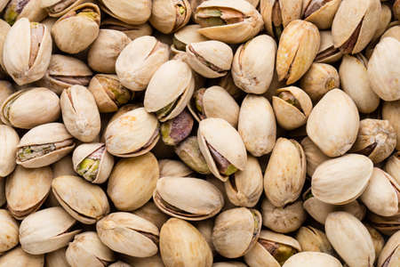nutshells: Background make from fresh salt pistachios. Stock Photo
