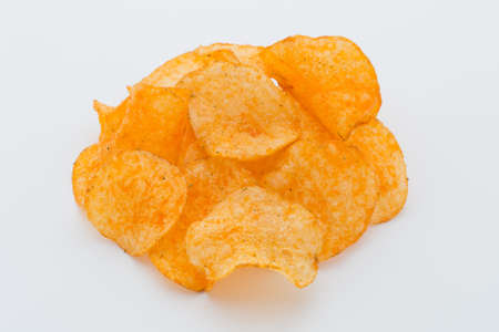 nosh: Crisps with paprica on a white background.