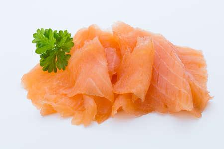 Close-up image of smoked salmon, studio isolated on white background.