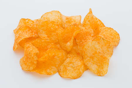 Crisps with paprica on a white background.