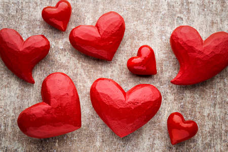 heartfelt: Hearts on the red color of the wood background. Stock Photo