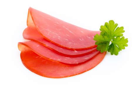 hams: lonchas de jamón de cerdo aisladas sobre fondo blanco. Foto de archivo