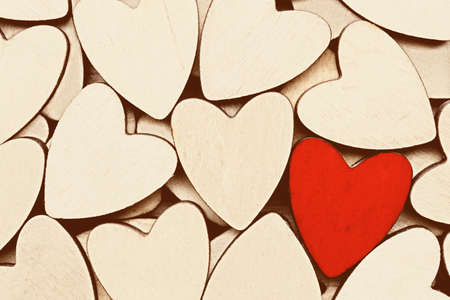 heartfelt: Wooden hearts, one red heart on the heart background. Stock Photo