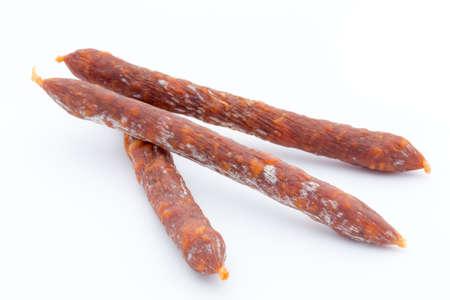Swiss style peperoni or salami, parsley sausage. Isolated on white background. Stock Photo