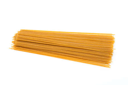 durum: Spaghetti yellow pasta, ready for cooking, isolated on the white background. Stock Photo