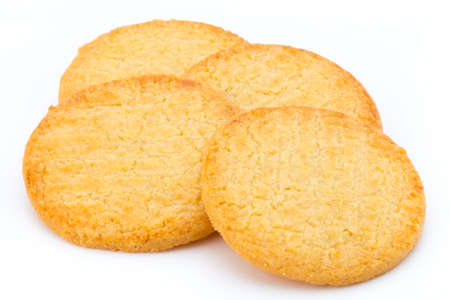 Stacked short pastry cookies isolated on white background.