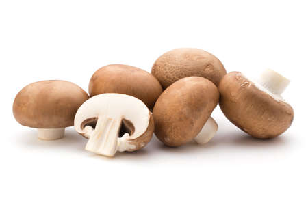 healthful: Fresh champignon mushrooms isolated on white. Stock Photo