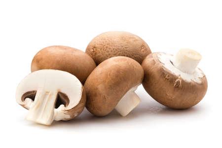 Fresh champignon mushrooms isolated on white. Фото со стока