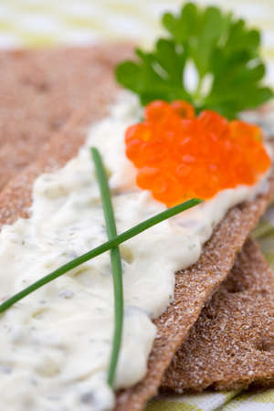 dietary fiber: Rye crispbreads with soft cheese with herbs and bacon. Stock Photo