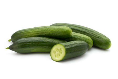 cuke: Eco cucumber on white background. Fresh vegetables. Stock Photo