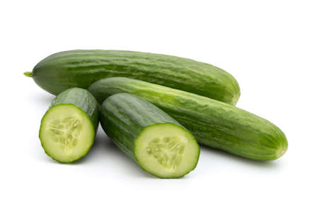 four objects: Eco cucumber on white background. Fresh vegetables. Stock Photo