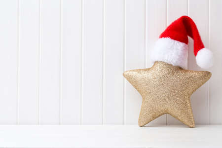 decorate: Christmas decoration on a white wooden background.