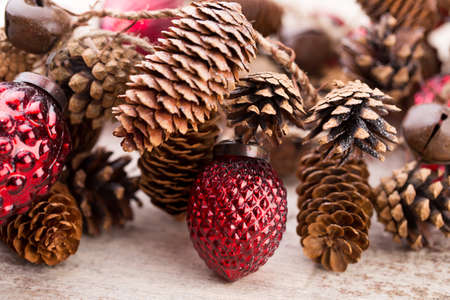 retro christmas: Christmas cone with red berries on a bokeh background. Stock Photo