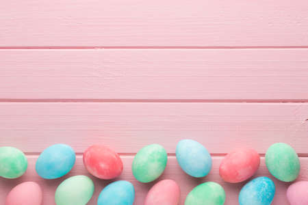 Pink pastel Easter eggs background. Spring greating card.